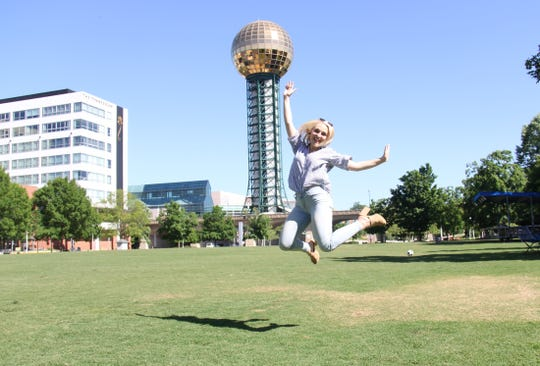 Allie Clouse jumps in front of the Sunsphere at World's Fair Park.