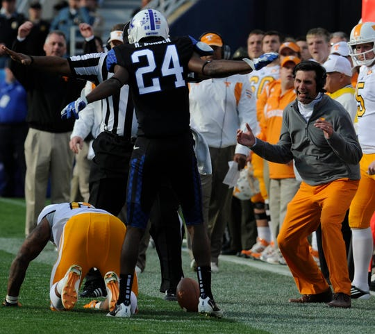 Tennessee head coach Derek Dooley, right, reacts to an incomplete pass against Kentucky at Commonwealth Stadium in Lexington on Saturday, Nov. 26, 2011. UT lost to UK for the first time since 1984 with a score of 10-7.(AMY SMOTHERMAN BURGESS/NEWS SENTINEL)