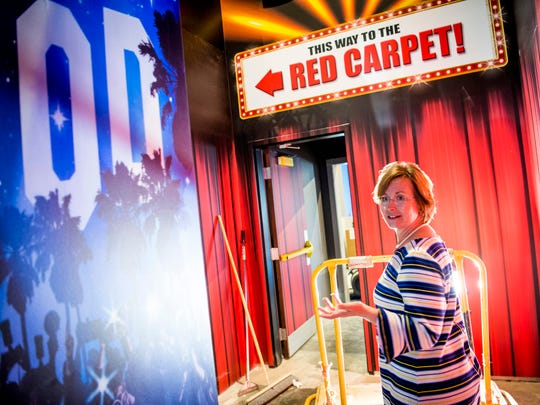 Holly Jones, office manager for National Enquirer Live, leads the News Sentinel through the red carpet room inside the Pigeon Forge attraction on Wednesday, May 22, 2019.