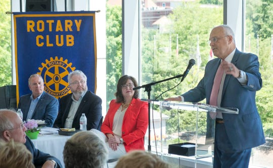 District Public Defender Mark Stephens addresses the Rotary Club of Knoxville after receiving the Rotary Peace Award Tuesday, May 21, 2019, at the Knoxville Museum of Art. At the head table are Chuck Bean, left, Crit Parrott, and Shannon Holland. Stephens and the staff of the Knox County Public Defender's Community Law Office were recognized for work upholding the ideals of Rotary International. (Paul Efird/Special to the News Sentinel)