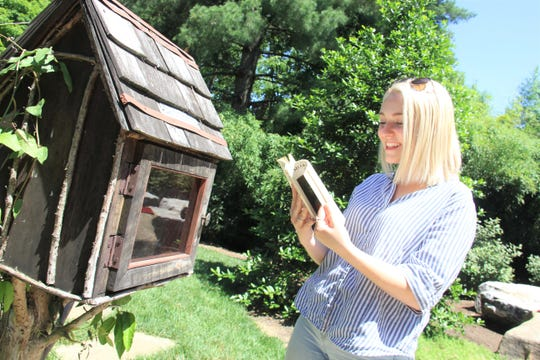 Allie Clouse reads a book at the Knoxville Botanical Garden and Arboretum.