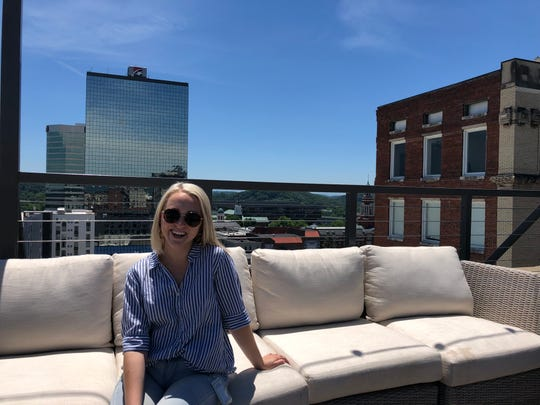 Allie Clouse poses for a photo at the Hyatt Place Downtown rooftop bar.