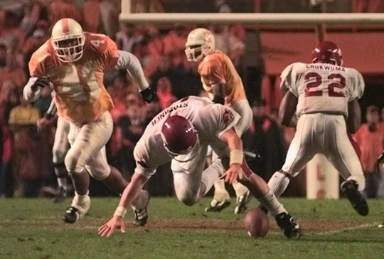 Arkansas quarterback Clint Stoerner fumbles the ball away late in the fourth quarter to set up Tennessee's winning touchdown drive on Saturday, Nov. 14, 1998, in Knoxville. Top-ranked Tennessee won the game, 28-24, and went on to win the national championship.