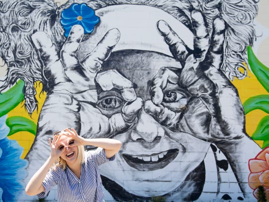 Allie Clouse at the Knoxville Graphic House mural.