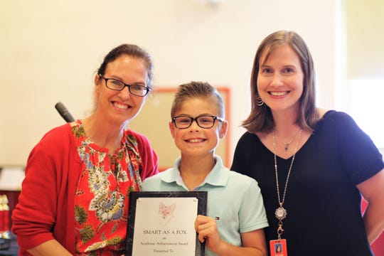 """Shannondale Elementary student Mason Dugan with the Smart as a Fox award. """"Despite all his academic achievements, he continues to push himself to improve,"""" said teacher Rhoshawnda Turner. With Mason are Shannondale principal April Partin, left, and teacher Melanie Ownby. May 17, 2019"""