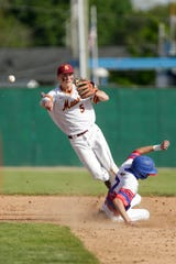 McCutcheon short stop Jarod Smith (5) throws to first as Kokomo short stop Payton McClain slides into second during the sixth inning of the first round of the 4a Baseball Sectional, Wednesday, May 22, 2019, at Loeb Stadium in Lafayette. McCutcheon won, 2-0.