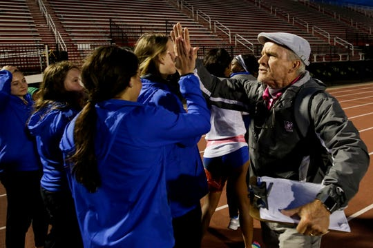 West Lafayette head coach Lane Custer high fives Hamilton Southeastern players after placing second to them in the IHSAA Regional girls track meet, Tuesday, May 21, 2019, at Lafayette Jefferson High School in Lafayette.