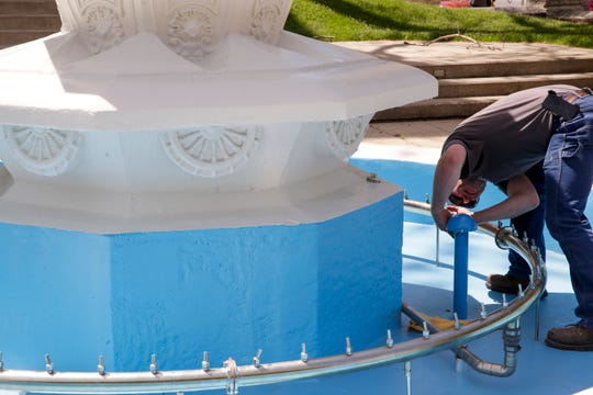 Jason Roehl, courthouse maintenance tech, works on the water fountain, Wednesday, May 22, 2019, outside the Tippecanoe County Courthouse in Lafayette.