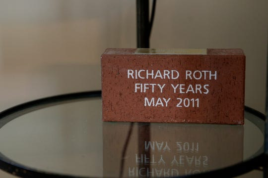 Rich Roth was presented a brick that sits on an end table in his home after attending 50 Indianapolis 500 races.