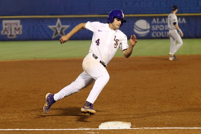 LSU baseball player Josh Smith comes around third base against South Carolina during the opening round of the SEC Baseball Tournament in Hoover, Alabama, on Tuesday, May 21, 2019.
