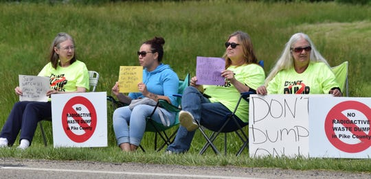 Protesters gather outside the Pike County YMCA Tuesday to show their disapproval of the low-level nuclear waste disposal site at the now deactivated Portsmouth Gaseous Diffusion Plant.