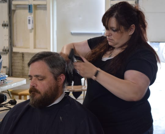 Corey Loar, a U.S. Army veteran, gets a free hair cut at the Stand Down event hosted by the LSS Faith Mission of Fairfield County on Wednesday.