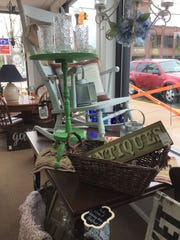 Furnishings, home decor, signs, glassware and other items for sale at Made 2 Inspire Resale Boutique's new location in downtown Howell, Wednesday, May 22, 2019.