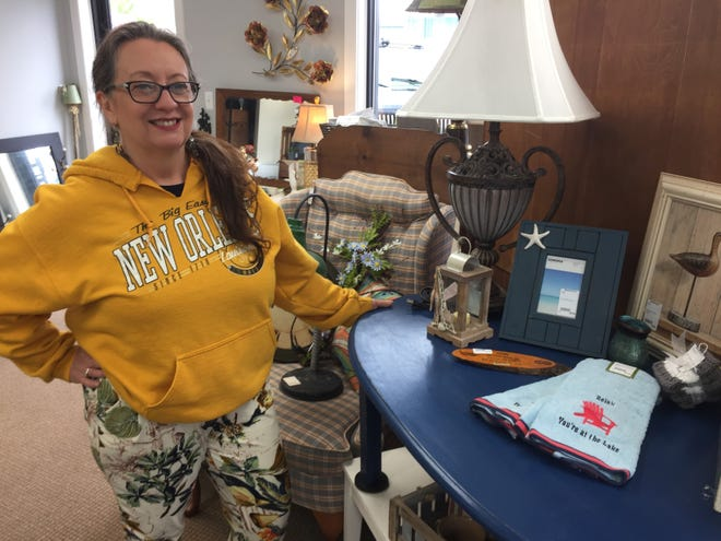 Kimberly Kennedy stands with a table she refurbished by painting it with chalk paint and other items for sale at her consignment shop Made 2 Inspire Resale Boutique, Wednesday, May 22, 2019. She recently moved the shop to downtown Howell from a previous location in Genoa Township.