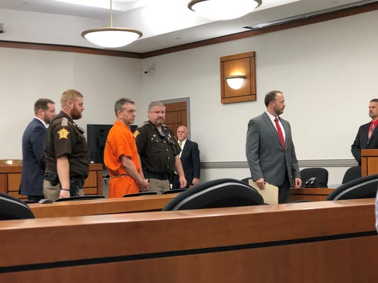 Christian Martin, center, appears in court in Hopkinsville to plead guilty to charges related to a 2015 triple murder. May 22, 2019