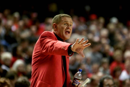 UL coach Denny Crum, in his last home game, directs his team.  3/3/01