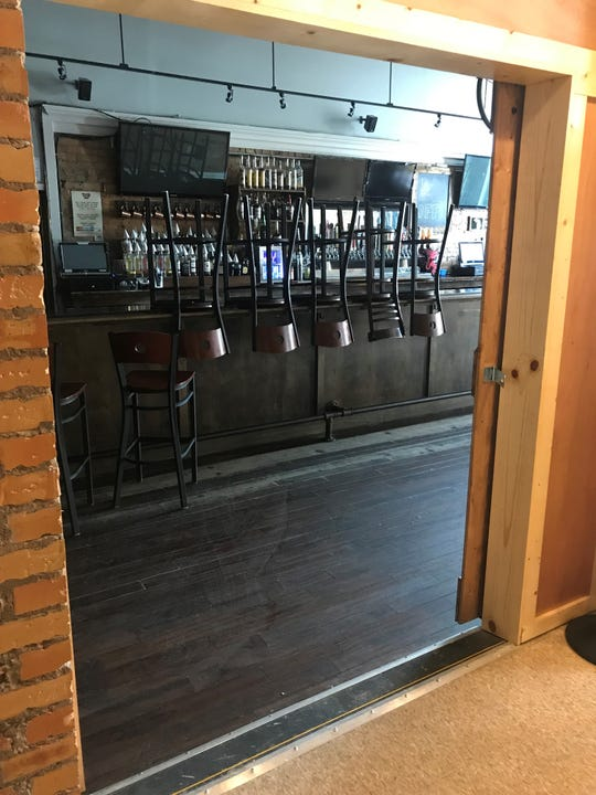 This is a door that connects Good Slice Pizza Co. to a bar called Taps 25. Both businesses are located on the 400 block of East Michigan Avenue in downtown Lansing.