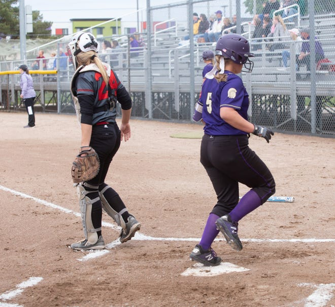 Fowlerville's Parker Douglass crosses home plate, Tuesday, May 21, 2019 at Hall of Fame Softball Classic.