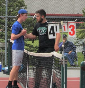 St. Peter's Luke Henrich and Clear Fork's Noah Brown meet at the net after their sectional championship match. Both have qualified for this week's state tournament near Cincinnati.