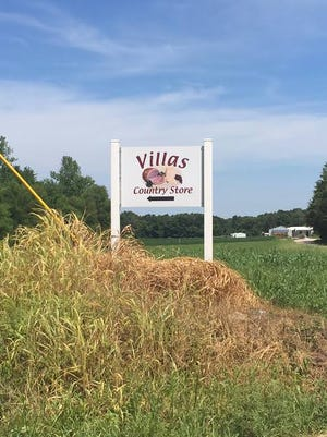 A sign points the way to Villa's, an Amish bakery and bulk food store owned by Gloria's Uncle.
