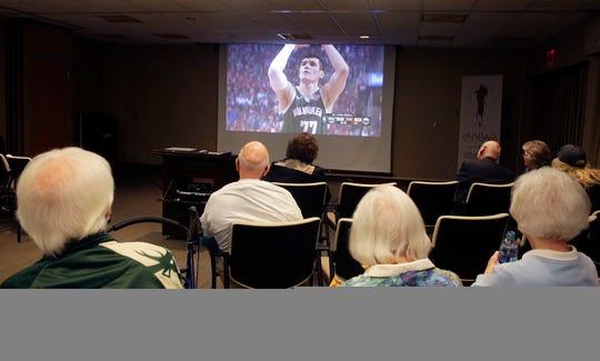 Milwaukee Bucks forward Ersan Ilyasova  sinks a free throw as residents at St. Camillus enjoy a Bucks game watch party.