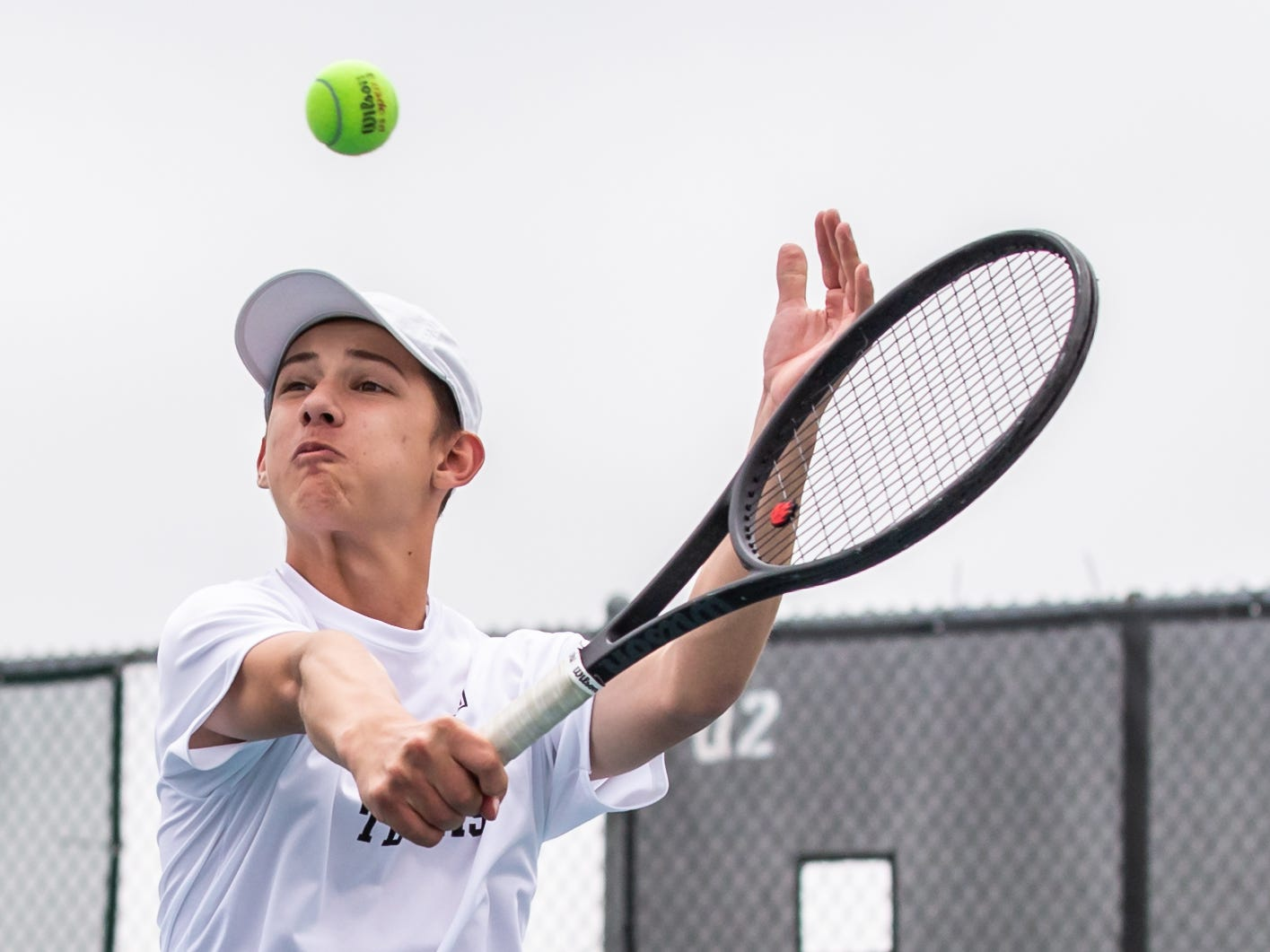 Menomonee Falls No. 1 doubles player Simon Blowers slices a backhand return during the WIAA Boys Tennis Sectional at Waukesha South on Wednesday, May 22, 2019.