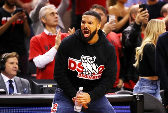 Rapper Drake gets fired up during the Raptors' Game 4 victory Tuesday night at Scotiabank Arena.