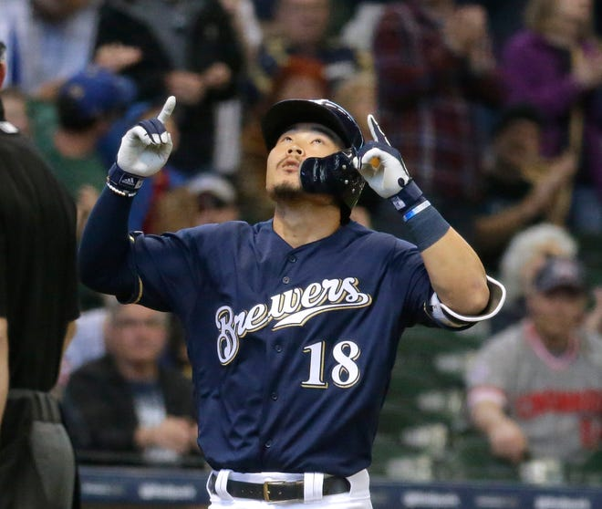 Brewers rookie Keston Hiura gives thanks after hitting a solo home run against the Reds in the second inning Wednesday.