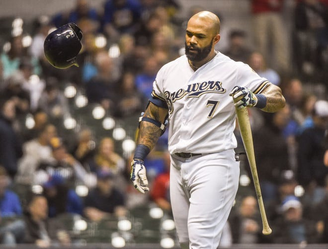 Brewers first baseman Eric Thames reacts after striking out in the eighth inning.