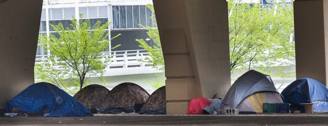 """An area underneath the Marquette Interchange is known as """"Tent City."""""""