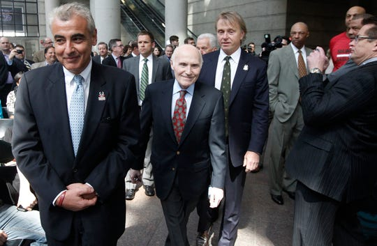 Milwaukee Bucks owner Herb Kohl (center) walks to the stage with prospective owners Marc Lasry (foreground) and Wesley Edens before a news conference announcing the sale of the Milwaukee Bucks April 16, 2014, at the BMO Harris Bradley Center in Milwaukee.