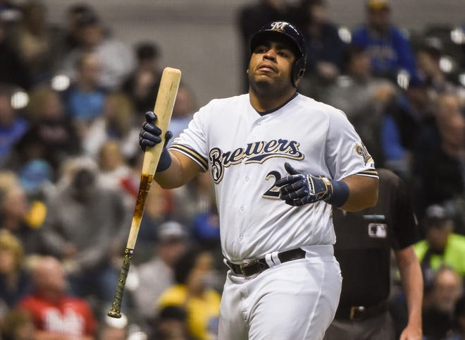 Brewers first baseman Jesus Aguilar walks back to the dugout after striking out.