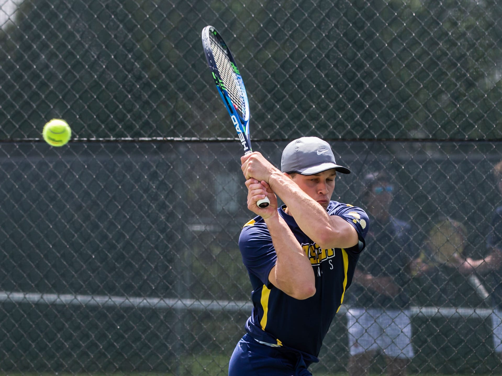 Kettle Moraine No. 2 singles player Connor Linzer runs down a corner shot during the WIAA Boys Tennis Sectional at Waukesha South on Wednesday, May 22, 2019.