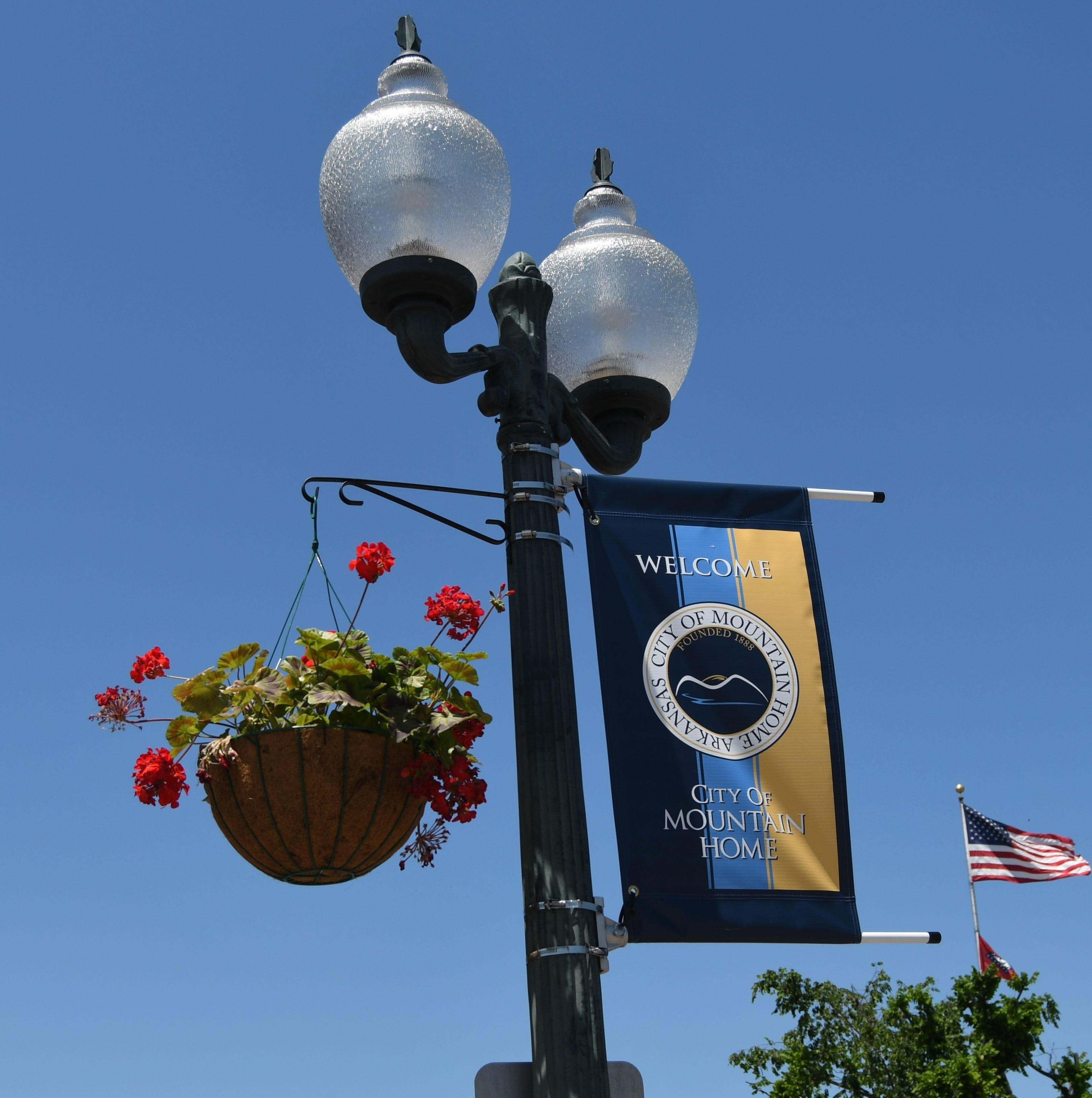 Banners, flowers now adorn square