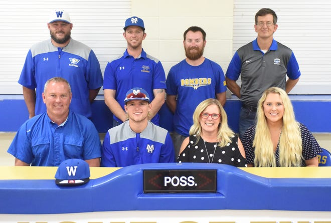Mountain Home's Luke Dibble (front, second from left) signed a National Letter of Intent on Wednesday to play baseball at Williams Baptist University. Pictured with Dibble are: (front row, from left) his father Tony Dibble, his mother Sharon Dibble, his sister Carly Dibble, (back row) Williams Baptist head coach Stephen Abanathy, Mountain Home head coach Tim Carver, Mountain Home assistant Blake Hendricks, and Mountain Home assistant Phillip Taylor.
