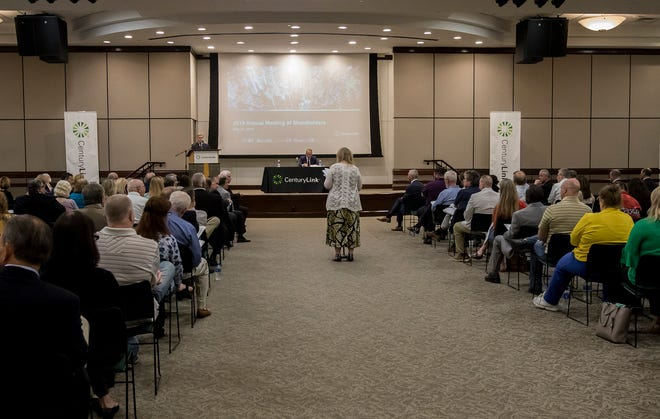 A shareholder addresses the chairman of the board during CenturyLink's annual shareholders meeting in Monroe, La. on May 22.