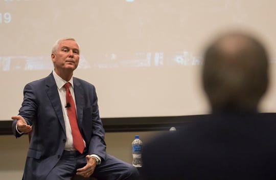 CenturyLink's CEO, Jeff Storey, addresses a shareholder during the informal session of the annual shareholders meeting meeting at the company's headquarters in Monroe, La. on May 22.