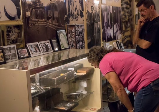 Hailing from New Plymouth, New Zealand, Catherine and Geordie Robb, view artifacts at the Bonnie and Clyde Ambush Museum in Gibsland, La. on May 21. Thursday marks the 85th anniversary of the criminal couple's death just south of the town.