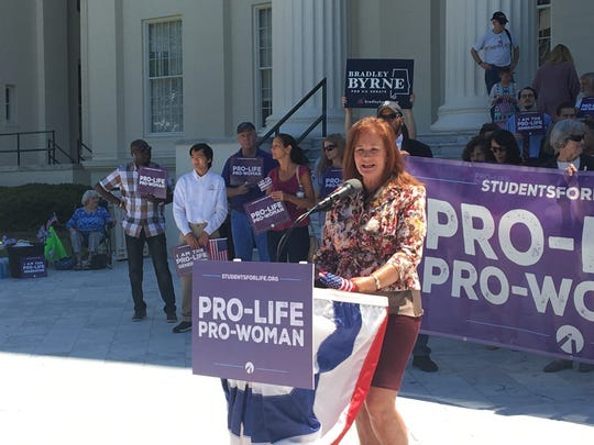 Rep. Terri Collins, R-Decatur, speaks at a rally celebrating the passage of a near-total abortion ban on May 22, 2019.