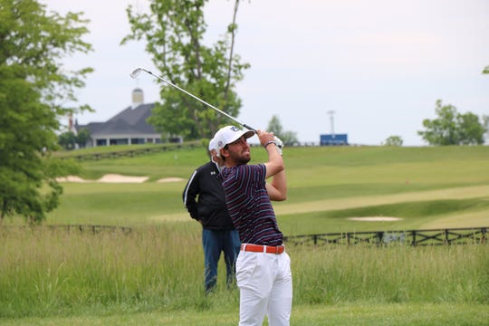 Auburn men's golfer Jacob Solomon completes a swing during the NCAA Men's Golf Louisville Regional.