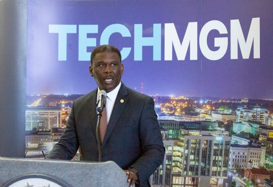 Willie Durham, chairman of the Chamber of Commerce, welcomes small and large tech officials to Montgomery for an announcement during the Montgomery IT Summit.