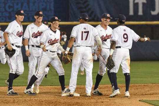 Auburn players celebrate a win over Tennessee in the SEC Tournament on Tuesday, May 21, 2019, in Hoover, Ala.