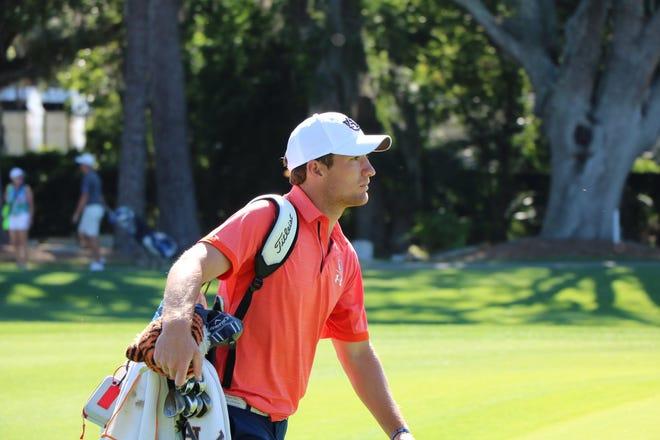 Auburn men's golfer Brandon Mancheno carries his golf bag at the SEC Men's Golf Championship.