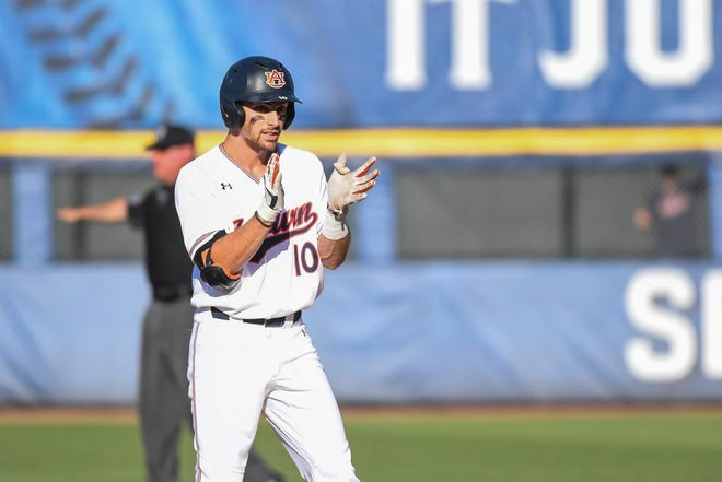 Auburn's Edouard Julien reacts after his two-RBI double against Tennessee in the SEC Tournament on May 21, 2019, in Hoover, Ala.