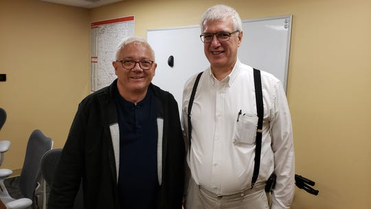 "Jeff Watters poses with Dr. Frederick Steiner at IU Health Ball Memorial Hospital, after ""meeting"" him."
