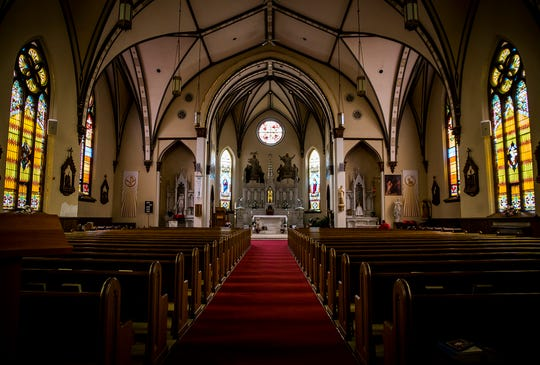 St. Lawrence Catholic Church is taking precautions as cases of COVID-19 spread through Indiana. The church has installed hand sanitizer dispensers and encourages attendees to not shake hands.