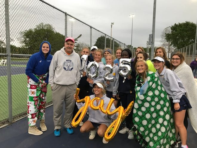 Delta girls tennis celebrates a regional semifinal victory. The win also gives the Eagles' Tim Cleland his 1,025th career win as a boys and girls tennis coach.
