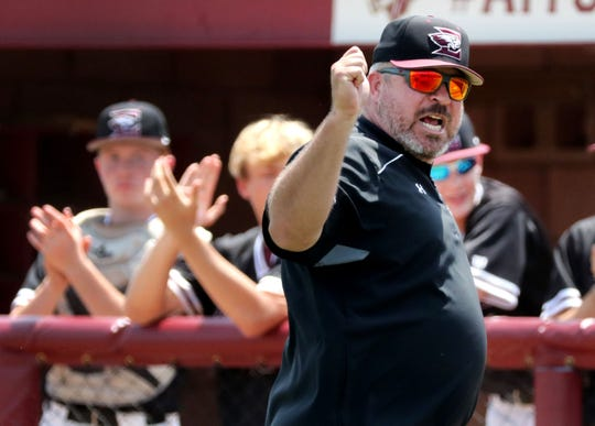 Eagleville's head coach Travis Holland yells at the officials as he leaves the field after being ejected from the game during the Class A State Baseball Tournament against Lake County on Wednesday, May 22, 2019, on the second day of Spring Fling, in Murfreesboro.