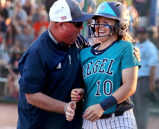 Siegel softball coach Shawn Middleton congratulates senior Caitlyn McCrary after she stole home during a state tournament game. McCrary is the DNJ's all-area softball Player of the Year and Middleton the Coach of the Year.