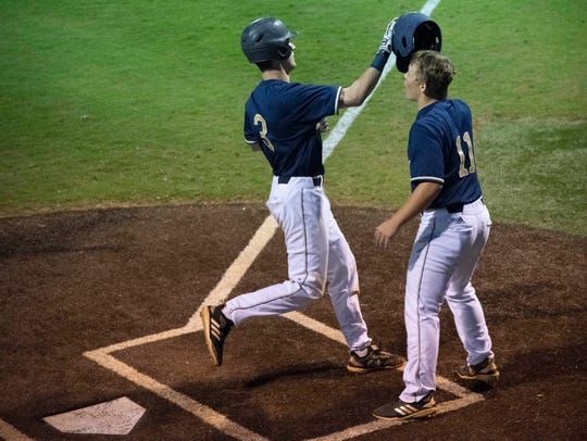 Independence's Robert Hassell (3) is congratulated by Jackson Riedling (11) after Hassell's two-run home run against Arlington during the TSSAA Class AAA State Baseball Tournament at Oakland High School Tuesday, May 21, 2019 in Murfreesboro, Tenn.